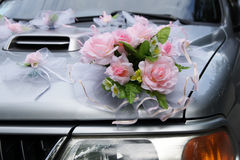 Decorations on the wedding car. Beautiful decorations made of artificial flowers at a wedding car Royalty Free Stock Photography