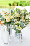 Decorations for the wedding ceremony. Flowers closeup. White flowers with green leaves, white wedding, exit ceremony, wedding in nature, floristry, decor, sunny Stock Photography
