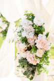 Decorations for the wedding ceremony. Flowers closeup. White flowers with green leaves, white wedding, exit ceremony, wedding in nature, floristry, decor, sunny Royalty Free Stock Images
