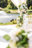 Decorations for the wedding ceremony. Flowers closeup. White flowers with green leaves, white wedding, exit ceremony, wedding in nature, floristry, decor, sunny Royalty Free Stock Image