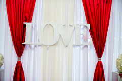 Decorations for the wedding feast. With red curtains Stock Images