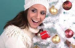 Decorative. Happy smiling woman on christmastree decorative royalty free stock image