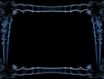 Blue smoke frame. Decorative abstract blue frame isolated over black background made of smoke. There is copy space to insert a text or an image Royalty Free Stock Photo
