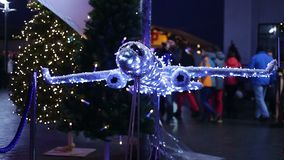 Decorative airplane made of sparkling twinkle lights at airport, Christmas tours. Stock footage stock video footage