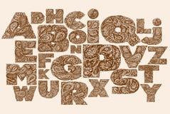 Decorative Alphabet with a paisley zen doodle tattoo ornaments f Stock Photos