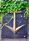 decorative anchor on the mosaic wall Stock Image