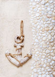 Decorative anchor on the sea sand Stock Image