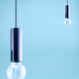 Decorative antique edison style filament light bulb on light blue background. Filtered image Stock Photography