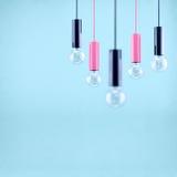Decorative antique edison style filament light bulb on light blue background. Filtered image Stock Photo