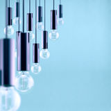 Decorative antique edison style filament light bulb on light blue background. Filtered image Royalty Free Stock Photos