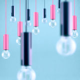 Decorative antique edison style filament light bulb on light blue background. Filtered image Royalty Free Stock Image
