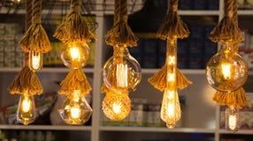 Decorative antique edison style filament light bulbs. Hanging Royalty Free Stock Photo