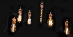 Decorative antique edison style filament light bulbs. Hanging Royalty Free Stock Photos