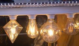 Decorative antique edison style filament light bulbs Stock Images