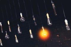 Decorative antique edison style light bulb. On dark background. Lighting decor royalty free stock images