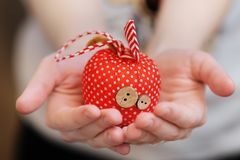 Decorative apple in woman's hands Royalty Free Stock Images