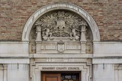 Decorative Arch above Main Entrance to Taunton County Hall. Bas-relief Shallow Depth of Field Royalty Free Stock Photo