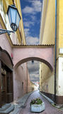 Decorative arch in center of old Vilnius cty, Lithuania. Arch above one of narrow medieval streets in old Vilnius city Stock Images