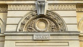 Decorative Arch And Keystone Above The Door Of A Bank. Shallow depth of field horizontal photography royalty free stock image