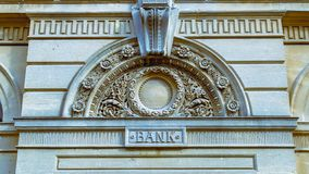 Decorative Arch And Keystone Above The Door Of A Bank Split Toni. Ng, shallow depth of field horizontal photography royalty free stock images