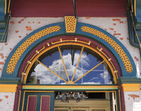 Decorative arched doorway. Brightly painted original antique arched doorway with glass fanlight above Royalty Free Stock Photo