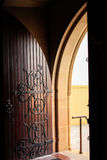 Decorative arched wooden church door Royalty Free Stock Photography