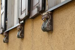 Decorative architectural elements under the windows for fastening the shutters.  stock photography