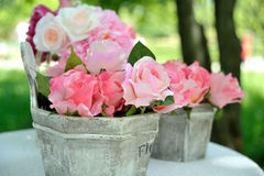 Decorative artificial roses flowers. In vase outdoor Royalty Free Stock Photo