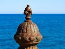 Decorative metal pole covered with rust Stock Image