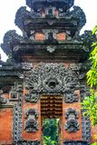 Decorative authentic elements of the building. An ancient architecture of Bali. Travel around Indonesia stock photos