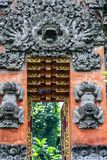 Decorative authentic elements of the building. An ancient architecture of Bali. Travel around Indonesia royalty free stock photo