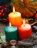 Decorative autumn candles burning with pumpkins and decorations Stock Image