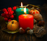 Decorative autumn candles burning with pumpkins and decorations Royalty Free Stock Photos