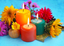 Decorative autumn candles and flowers Royalty Free Stock Photo