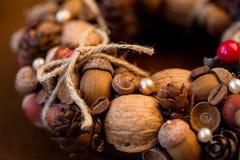 Decorative autumn wreath. With acorns and cones close-up stock photos