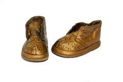 Decorative baby shoes. Old decorative baby shoes on white background Royalty Free Stock Photos