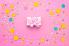 Decorative background with colored buttons in bulk and gift box. Top view flat lay stock image
