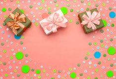 Decorative background with colored buttons in bulk and gift box. Top view flat lay Royalty Free Stock Photo
