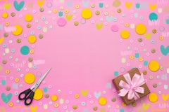 Decorative background with colored buttons in bulk and gift box. Top view flat lay stock photo