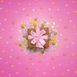 Decorative background with colored buttons in bulk and gift box. Top view flat lay stock photos
