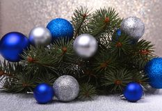 Decorative background with fir branches and balls on the silver. Christmas card Holiday Concept Stock Photos