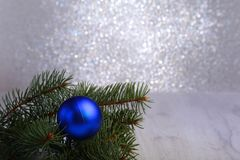 Decorative background with fir branches and blue balls on the silver. Christmas card Holiday Concept stock photography