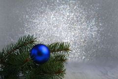 Decorative background with fir branches and blue balls on the silver. Christmas card Holiday Concept Royalty Free Stock Image
