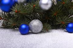 Decorative background with fir branches and balls on the silver. Christmas card Holiday Concept Stock Photo