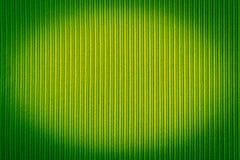 Decorative background green color, striped texture, vignetting gradient. Wallpaper. Art. Design. Decorative background green color, striped texture, vignetting stock image