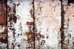 Coated metal. Decorative background of old metal, prone to corrosion. Decorative background of old metal, prone to corrosion.The rust on the metal shows through Stock Photography
