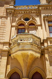 Decorative balcony above the portal to the Bishop's Palace in. Decorative balcony above the portal to the Bishop`s Palace on the Pjazza San Pawl in Mdina Royalty Free Stock Photography