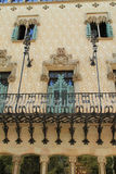 Decorative balcony and windows of Las Ramblas building in Barcelona. Decorative stone and tiled balcony and windows of building in Las Ramblas, Barcelona, Spain stock photography