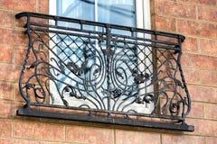 A decorative balcony. A wrought metal Stock Photos