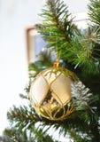 Decorative ball on the Christmas tree Stock Photos
